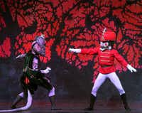 """The Nutcraker, played by Simon Wexler, battles King Rat, played by Thomas Kilps, in Texas Ballet Theater's """"The Nutcracker"""" during dress rehearsal at Bass Hall in Fort Worth."""