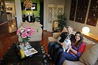 Dayne and Lindsay Hollmuller (with their dog, Charlie) are on opposite sides of the design spectrum. HGTV's House Hunters featured their attempt to achieve a stylishly blended household.