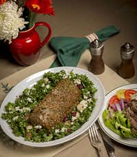 A chateaubriand cut beef tenderloin wit kale salad, shot Monday, October 28, 2013 at the home of Anne Greer McCann in far north Dallas. On the right is  a steakhouse salad made with the traimmings of the meat.  The napkins and place setting are Williams Sonoma.