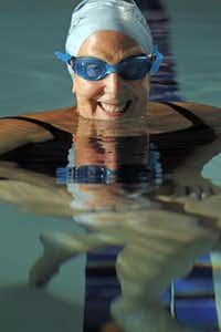 Randi Schwartz in the Verandah Club swimming pool at the Hilton Anatole in Dallas, Thursday, October 24, 2013. Schwartz had a hip replacement and has taken up swimming for her rehabilitation.