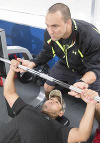 Ruben Castillo, 37, (with trainer Mike Sanchez) says he has reached a happy medium with his workout regimen and is no longer trying to bulk up beyond his body's capability.