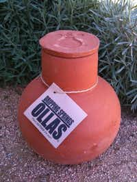 Ollas are a low-tech way to keep plants watered. The unglazed clay pots are buried in the ground and filled with water. The water seeps through into the surrounding soil.Dripping Springs Olla