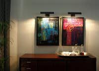 Wall Decor from the home of David Smith and his partner Michael Melvin were repurposed and reframed by Creative Consultant Stephen Toon in their Plano, Texas home on Friday, August 3, 2012.