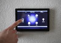 A Control4 Smart Home System allows a homeowner to control lights, television, security and music systems automatically.