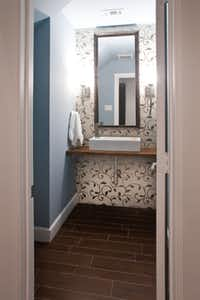 The homeowners requested Gilliam build a wood vanity with sinks like those pictured in this Modern Craft photo posted on Houzz.com.