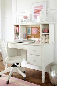 The Madeleine storage desk and hutch has a keyboard drawer and two roomy side drawers. Sold separately at the sale prices, $148.99 to $399. Available in white or brushed gray. Carolina swivel chair $139.99 to $199 on sale. At Pottery Barn Kids and potterybarnkids.com.King Au  - Pottery Barn Kids