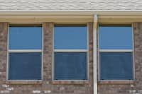 Windows have low E (low emissivity) coating to reflect ultra violet rays.
