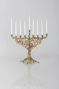 American jewelry and home collections designer Jay Strongwater's Solomon floral and vine hanukkiah is a compilation of cast pewter with a matte gold and brown antique finish, enamel and Swarovski crystals. $2,700 at Neiman Marcus NorthPark Center, Dallas, and neimanmarcus.com.
