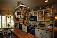 The kitchen gets its cottage appeal from a blend of textures and finishes.