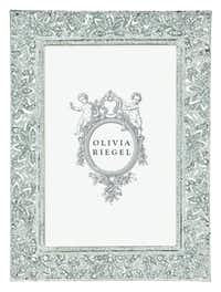 An elegant photo frame inspired by estate jewelry is from local manufacturer Olivia Riegel. The Windsor frame is set with dozens of Swarovski clear crystals and holds a 5 by 7 photo. $150 at Stanley Korshak, Dallas