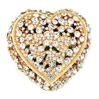 A jeweled box by Olivia Riegel is the way to show her she has your heart. Hand-set with Swarovski clear crystals in gold-tone metal, the interior is hand-enameled in a celadon color. $180 at Stanley Korshak, Dallas