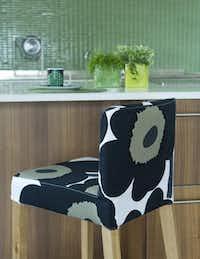 Update Ikea's Henriksdahl tall chair with a Unikko slipcover. Covers start at $129, bemz.com.Bemz<219,4,200>