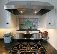 The backsplash in the remodeled kitchen of Jackie and Doug Sweat's home on Junius Street in Munger Place  on Tuesday, August 27, 2013.
