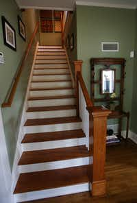 A look at the staircase from the foyer of Jackie and Doug Sweat's home on Junius Street in Munger Place  on Tuesday, August 27, 2013.