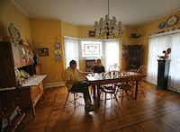 Doug and Jackie Sweat enjoy time in the dining room at their home on Junius Street in Munger Place  on Tuesday, August 27, 2013.