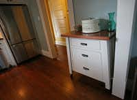 A custom piece of furniture in the kitchen of Jackie and Doug Sweat's home on Junius Street in Munger Place  on Tuesday, August 27, 2013.