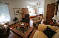 The master bedroom of Jackie and Doug Sweat's home on Junius Street in Munger Place  on Tuesday, August 27, 2013.