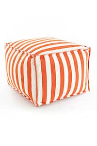 WEATHER-POUF: Crafted with bright-striped durable polypropylene fabric and filled with polystyrene beads, the Trimaran pouf works for the patio — even on a boat anchored at the lake — and is available in tangerine or bright pink. $295 at Hess, Dallas.