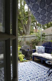 Pinterest's 30 Days of Creativity inspired Selena Urquhart to stencil the deck and install a sail shade over the seating area