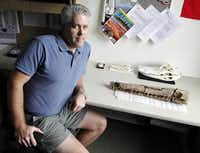 """SMU paleontologist Thomas Adams says the discovery of the fossilized remains of a Terminonaris (foreground) in North Texas prompts questions. """"We have to really rethink: Did this group really originate in Europe and disperse west?"""" he said. """"Or is it more likely that it originated in Texas?"""""""