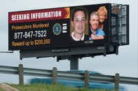 A billboard in Dallas publicizes a reward of up to $200,000 for information about the murders of Kaufman County District Attorney Mike McLelland, his wife, Cynthia, and Assistant District Attorney Mark Haase.