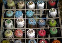 """Cans of uncapped spray paint were part of the artists' palette for Saturday's initial tagging of the new """"free wall."""""""