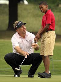 J. Erik Jonsson Community School fifth-grader Christopher Turner Jr. got a putting lesson from PGA pro Ken Duke on the 17th hole of the Pro-Am round at the HP Byron Nelson at the Four Seasons Resort in Irving.