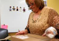 Maria Berry's efforts are so appreciated at Barron Elementary School that a co-worker made five small paper dolls to symbolize the need for more of her.
