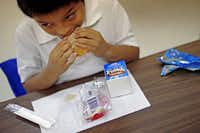 Israel Lopez, a 5-year-old kindergarten student at Holland Elementary School in east Oak Cliff, chows down on a burrito as part of the Breakfast in the Classroom program.