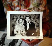 Ann Ticknor holds a photo taken of her and husband, Hal, at their wedding.