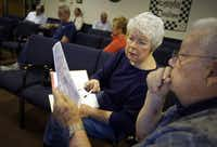Sharon Carlton and Ron Morgan looked over a map during a meeting Wednesday at First United Methodist Church Garland.