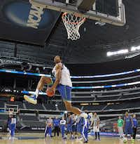 Florida Gulf Coast's Eric McKnight moved in for a dunk Thursday as the Eagles prepared for the next round of the NCAA Tournament  at Cowboys Stadium in Arlington.