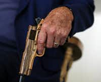 Howard, 82, who lives on a ranch near Prosper, gripped the gun-shaped handle of his cane as he spoke Monday.