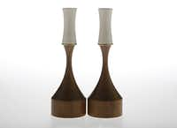 Bring a midcentury touch to the table with a pair of porcelain candleholders on walnut bases by KleinReid of New York. $245 the pair at Nest Dallas.