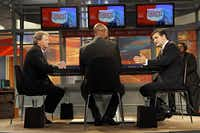 """Ted Cruz (right), taking a question from The News' Gromer Jeffers Jr. (center), cast little-known Democratic rival Paul Sadler as an """"unapologetic liberal."""" A visibly angry Sadler, meanwhile, repeatedly accused Cruz of lying."""