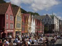 The World Heritage listed old wharf area of Bryggen, where 62 buildings remain and cobblestones are the norm, is now a trendy bar, restaurant and shopping precinct. Bergen, Norway.