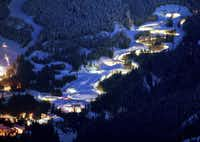 Lights glow around the Whistler Sliding Center track.  It's nearly a mile long, drops 499 feet and sports16 corners.