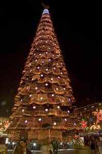 A 50-foot-tall artificial Christmas tree decorated with hundreds of round, red and black Pepsi logos looms over the festivities.