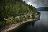 En route to the resort town of Banff, The Rocky Mountaineer runs for several miles along the banks of Suswap Lake in British Columbia.