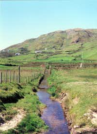 A Clare Island stream running from the hill to the sea. The island is reached by ferry from Roonaugh Pier, 18 miles from Westport.