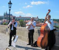 Like the Rialto in Venice, Prague's Charles Bridge is an always-busy promenade.  Here, musicians play to the crowd, with part of the Prague skyline as a backdrop.