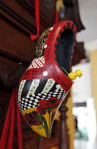 A wooden shoe in the collection of Sheri Geisler of Double Oak, handpainted by her sister.