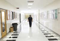 Richardson Police Officer and School Resource Officer La'Evening Woodard patrols the halls of Berkner High School in Richardson.