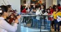 Parents and students at the open house listen to a Mariachi Band from the Grand Prairie Fine Arts Academy.