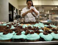 Culinary Arts student Sonia Martinez prepares cupcakes to sell in the school coffee shop during the Dubiski Career High School open house.