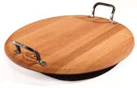 Turn, turn, turn: When extended family is expected for Thanksgiving dinner, a serve board that doubles as a lazy Susan is just the trick for serving appetizers or side dishes. Handmade from French oak wine barrels, it measures 22 inches and has cast iron handles. $445 at Nest, Dallas