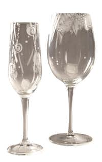Salud! Toast the holidays with wine glasses designed by local artist Polly Gessell. Patterns are sandblasted by hand. No two are exactly alike. $37.50 each at Nuvo, Dallas