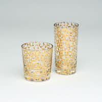 All that glitters: Holiday beverages shimmer in highball and double old fashioned cocktail glasses accented with a choice of 18K gold or sterling silver geometric pattern. Each holds 20 oz. $26 each at Bishop Street Market, Dallas