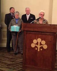 Patty Bozeman, holding blue box, accepts award on behalf of her late husband Gnat BozemanDeborah Fleck