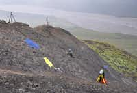 Anthony Fiorillo, a paleontologist and curator of earth sciences at the Perot Museum, works on a slope in the Alaska range of Denali National Park. He believes the hadrosaurs whose tracks they found were year-round residents of the Arctic, surviving months of darkness and cold temperatures.Perot Museum of Nature and Science